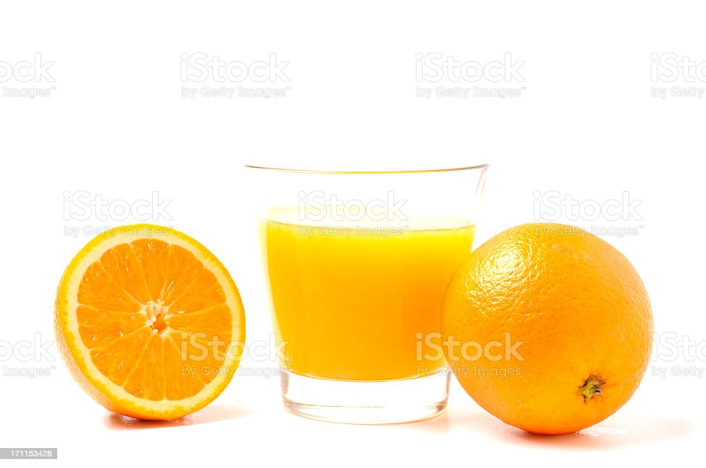 Oranges and glass of juice royalty-free stock photo