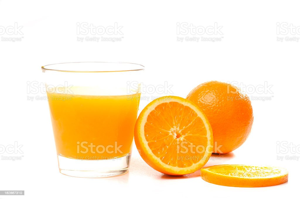 Oranges and glass of juice stock photo