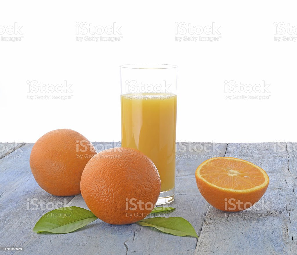 Oranges and glass of orange juice royalty-free stock photo