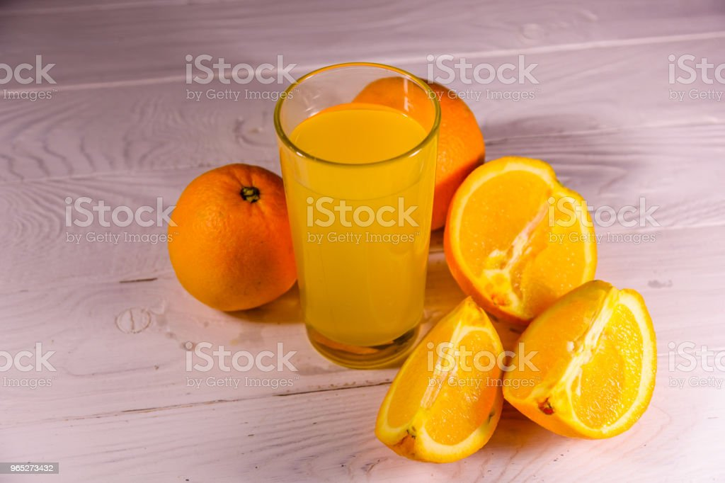 Oranges and glasses with orange juice on a wooden table zbiór zdjęć royalty-free