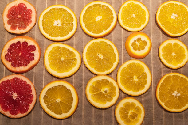 oranges and graprfruit in oven being dried for diy projects and zero waste Christmas decorations stock photo