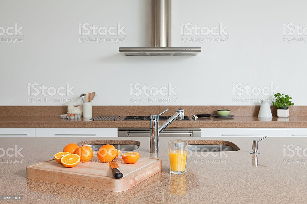 Oranges and orange juice on kitchen counter royalty-free stock photo