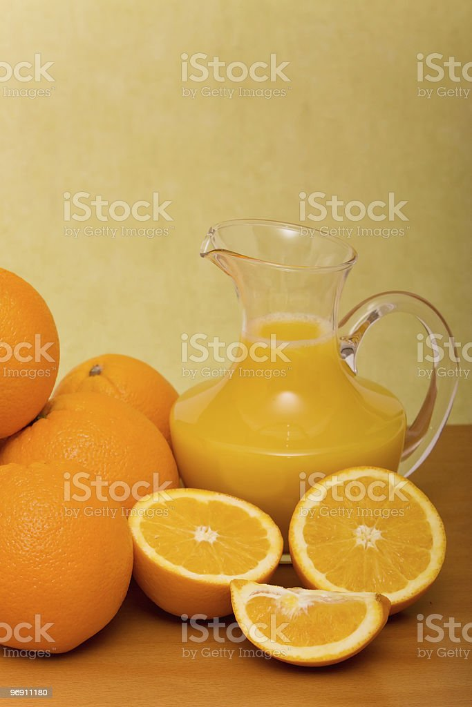 Oranges and pitcher of orange juice royalty-free stock photo