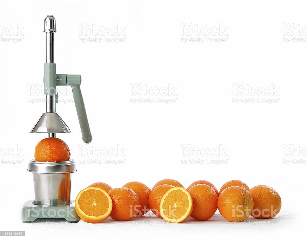 oranges and squeezer royalty-free stock photo