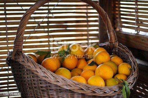Oranges in a wooden basket