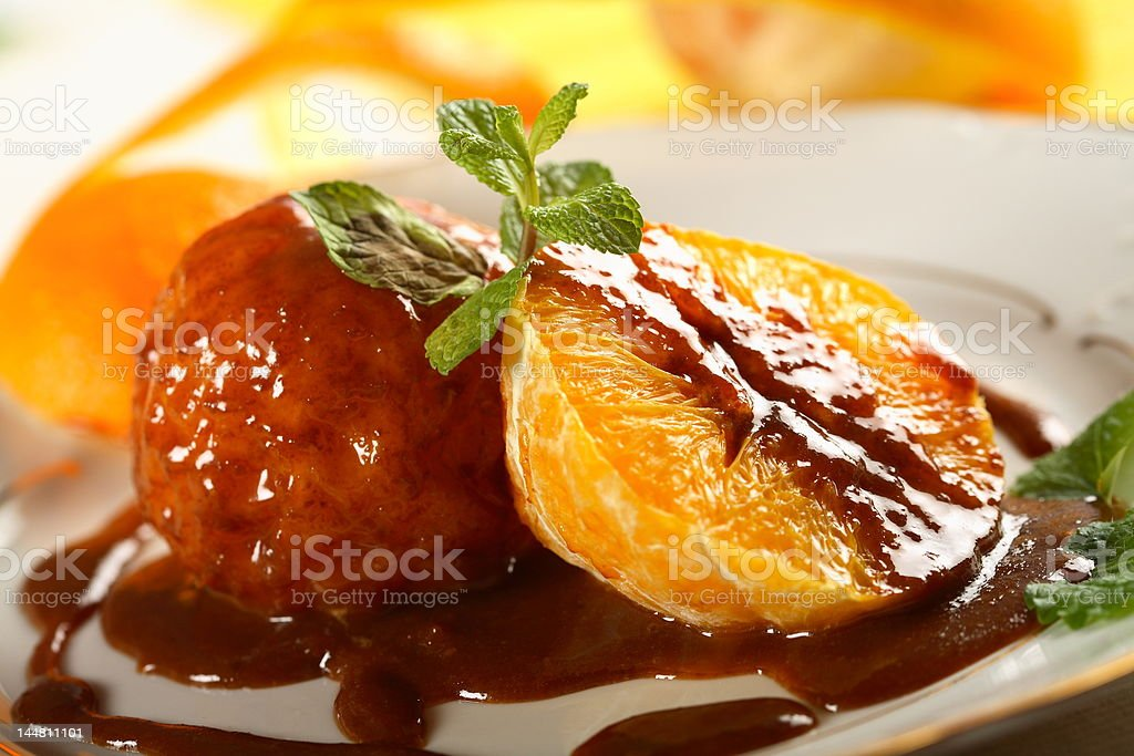 Oranges in chocolate dressing royalty-free stock photo