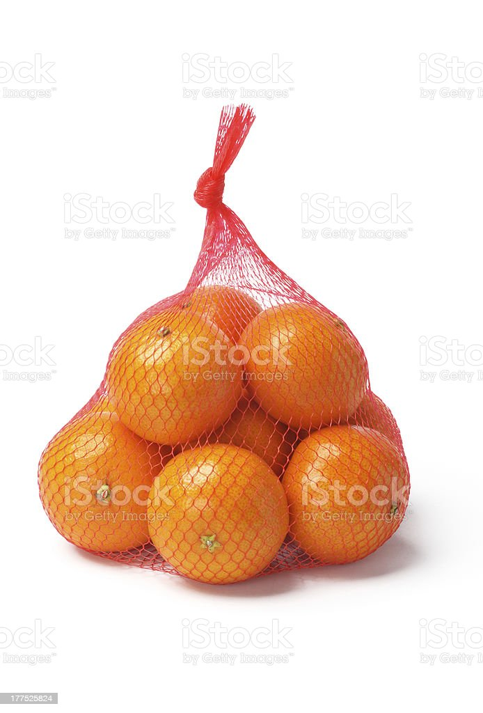 Oranges in Plastic Mesh Sack stock photo