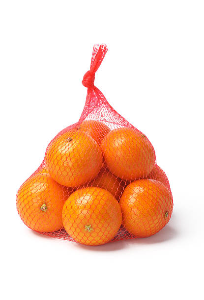 Oranges in Plastic Mesh Sack Fresh Oranges in Plastic Mesh Sack on White Background netting stock pictures, royalty-free photos & images