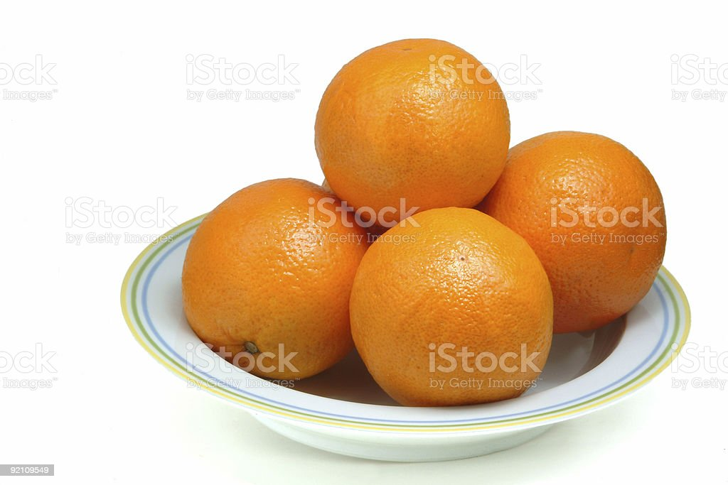 Oranges in plate royalty-free stock photo