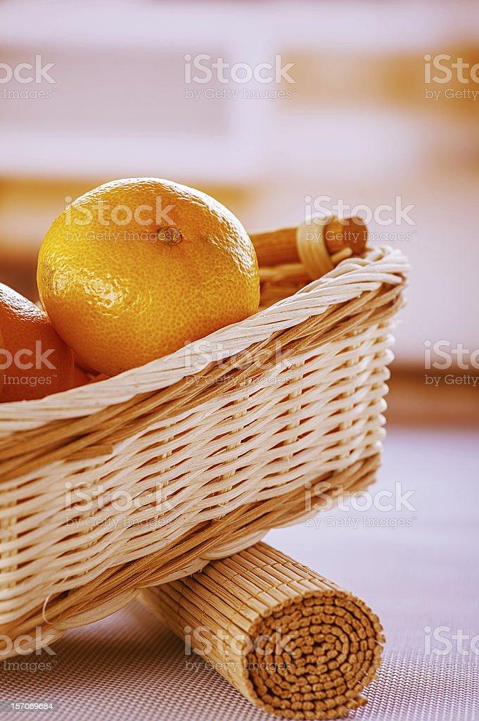 Oranges in wicker basket royalty-free stock photo