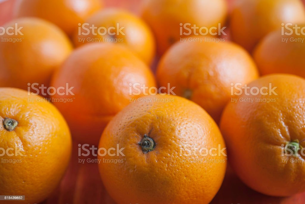 oranges on weathered wooden table stock photo