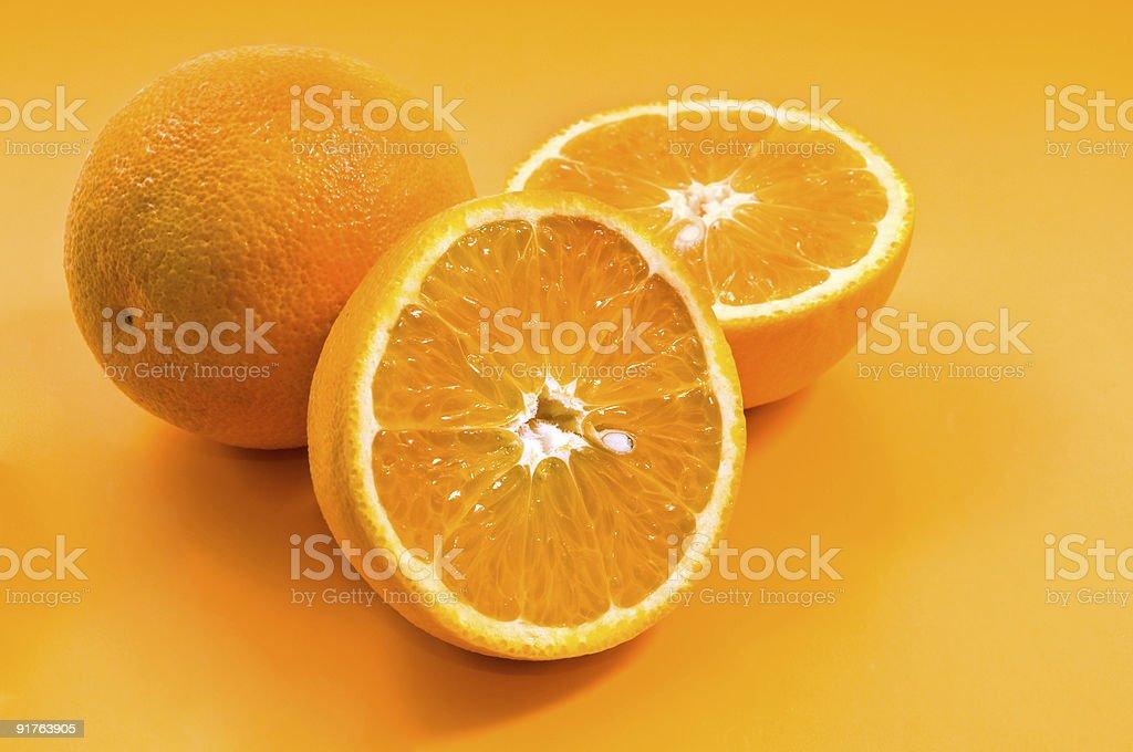 oranges on yellow royalty-free stock photo