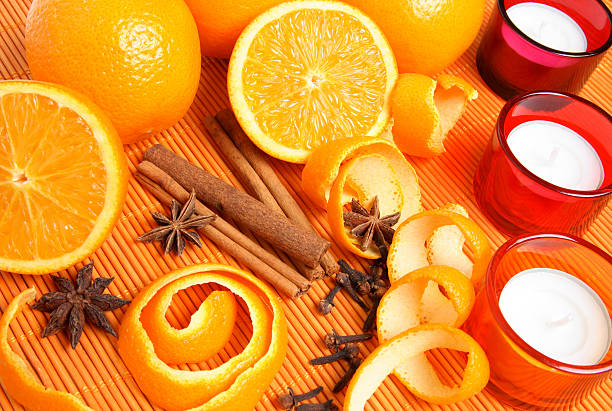 Oranges, spices and candles stock photo