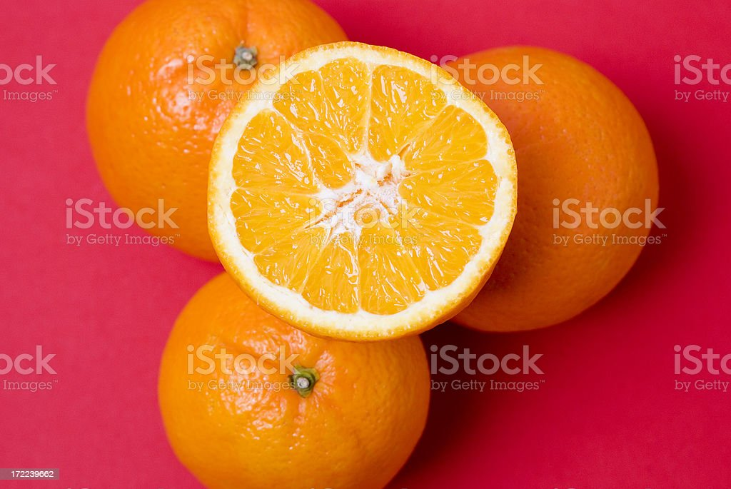 Oranges With A Red Background royalty-free stock photo