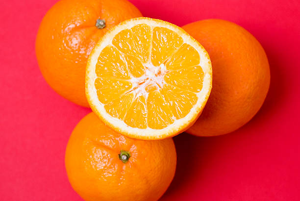 Oranges With A Red Background stock photo