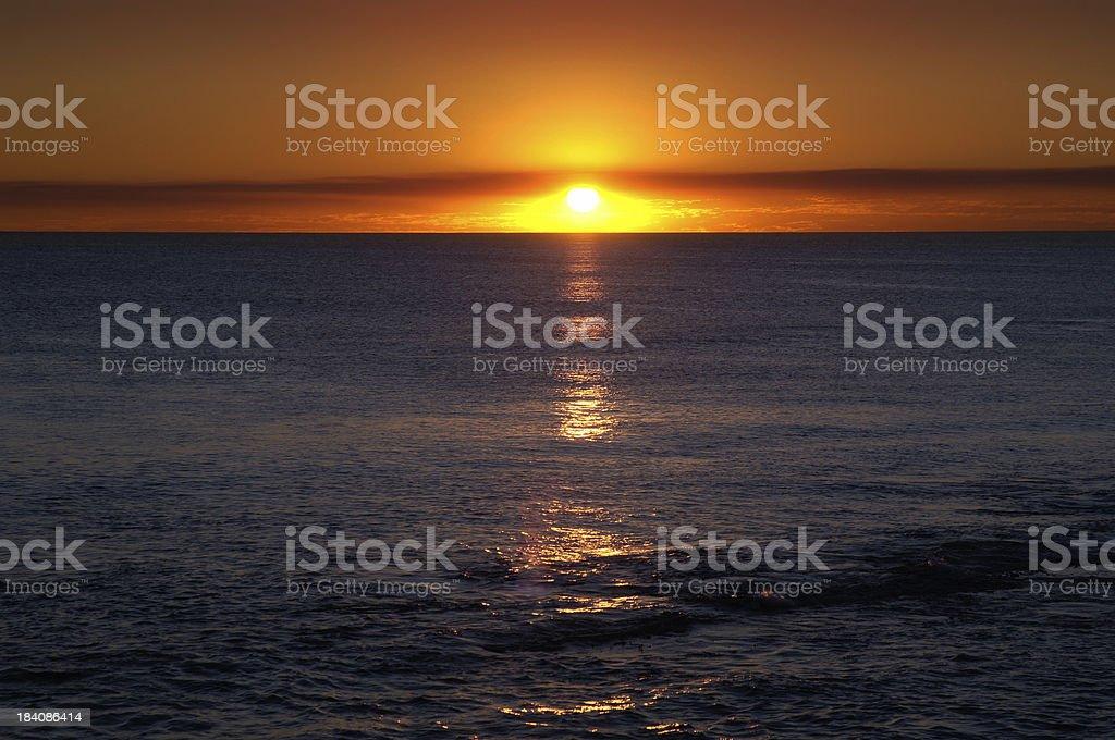 Orangle Globe Over the Western Sea stock photo