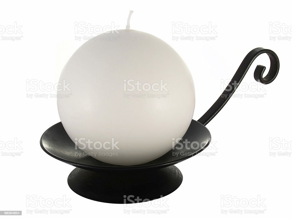 Orb candle on worught iron holder royalty-free stock photo