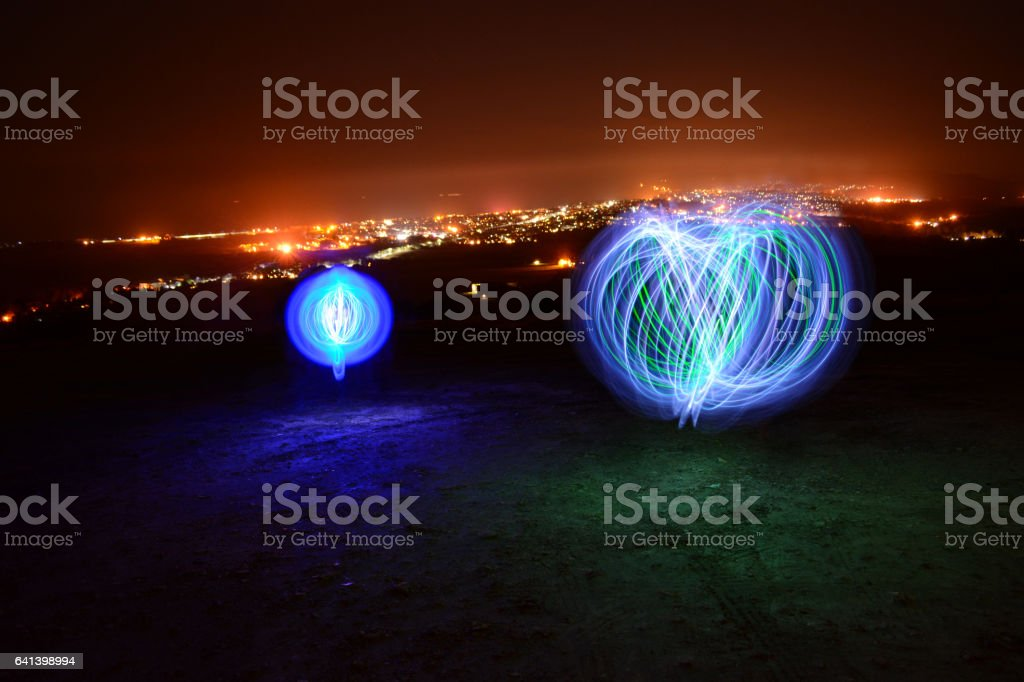 Orbs, Trails and Town Lights. stock photo