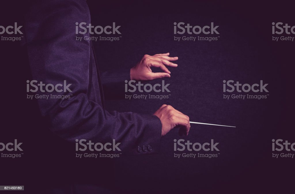 Orchestra conductor hands, Musician director holding stick on dark background stock photo