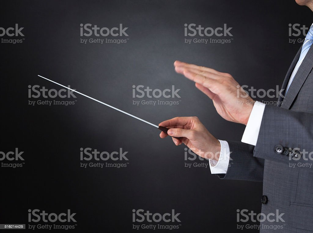 Orchestra Conductor Holding Baton stock photo