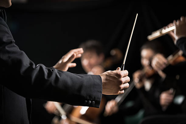 orchestra conductor on stage - classical stock photos and pictures