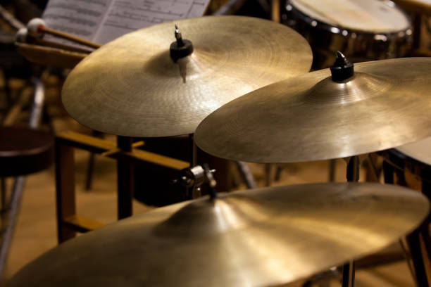 Orchestral cymbals Orchestral cymbals closeup in dark colors cymbal stock pictures, royalty-free photos & images