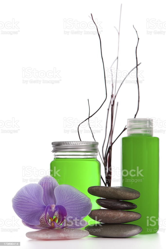 Orchid, stacked pebbles and spa products royalty-free stock photo