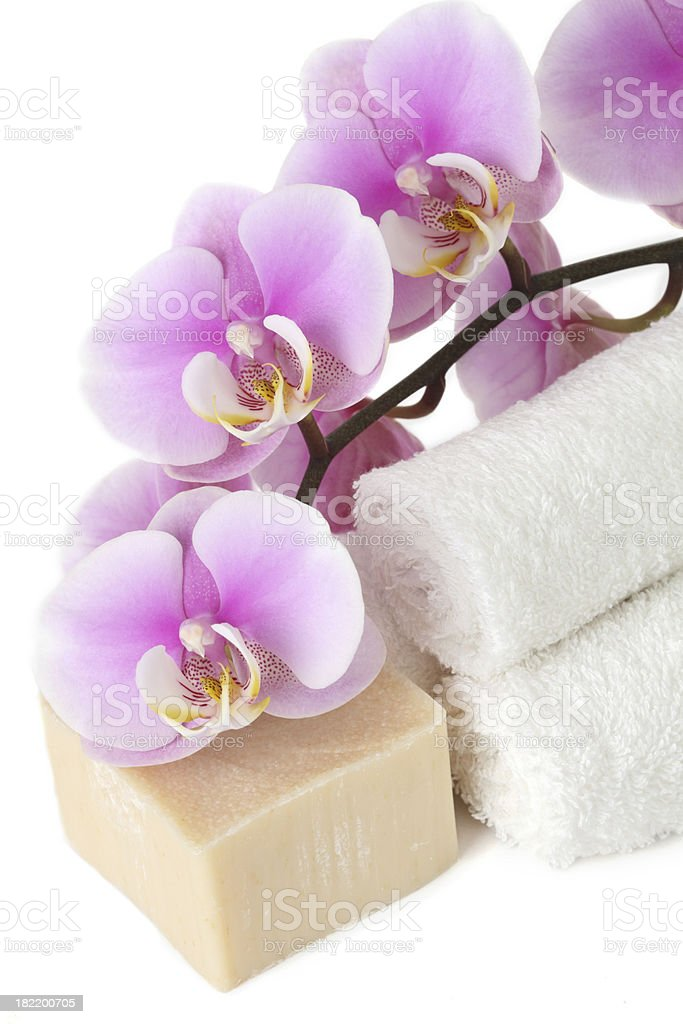 Orchid with towel  and bar of soap royalty-free stock photo