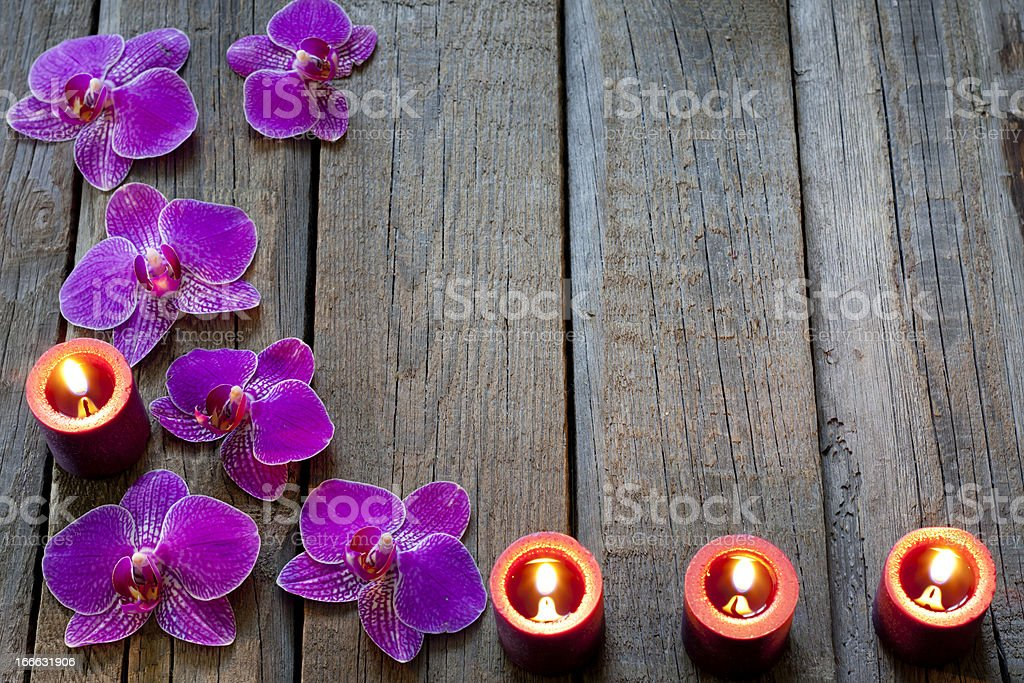 Orchids and candles background concept royalty-free stock photo