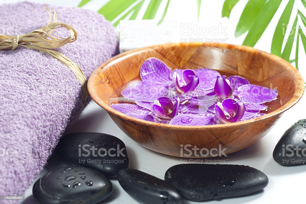 Orchids in the bowl with towel spa cosmetic concept royalty-free stock photo