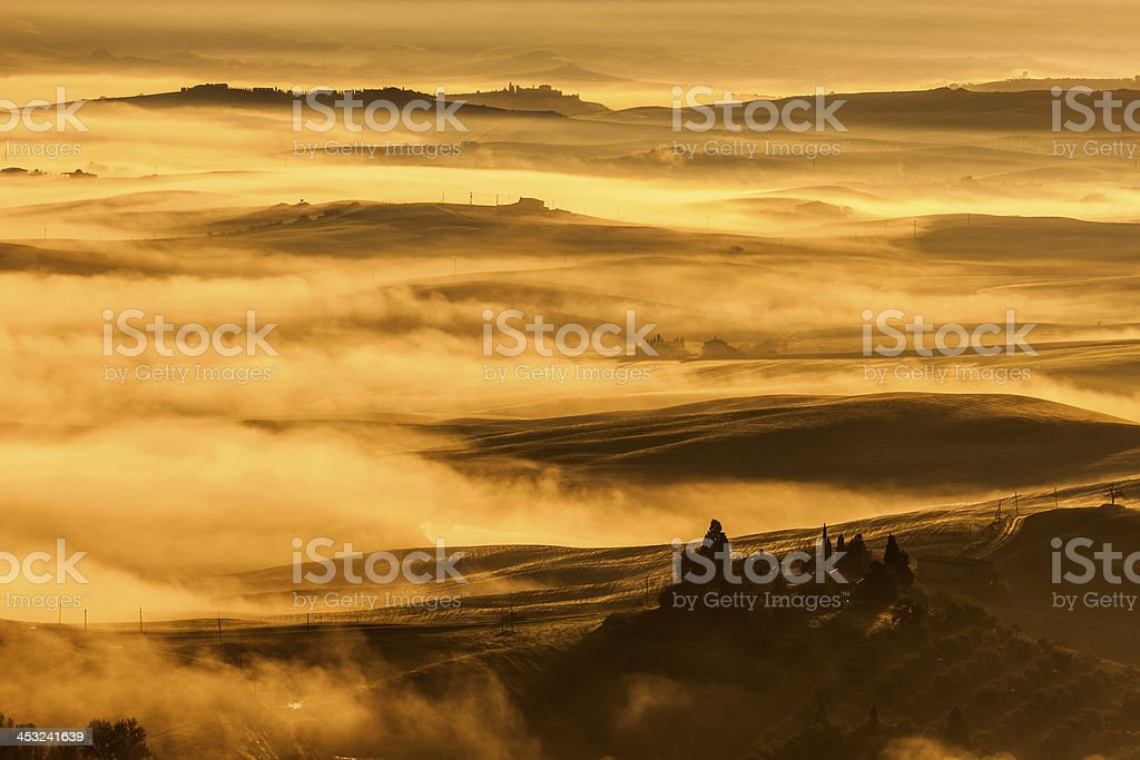 Orcia Valley Covered With Fog at Sunrise, Tuscany, Italy royalty-free stock photo