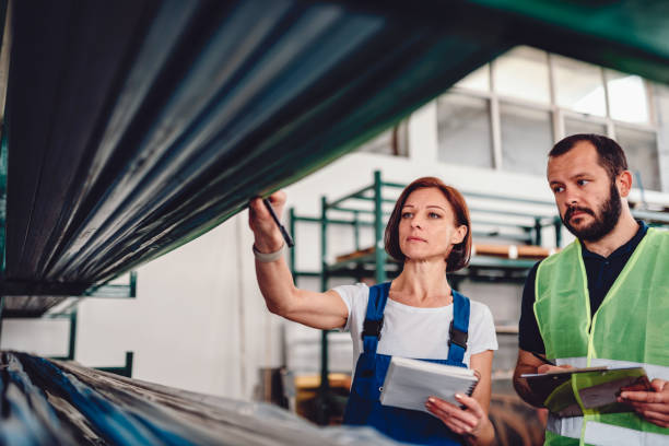 Order picker collecting products in the warehouse stock photo