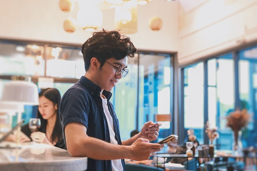take away customer is paying with contactless payment at coffee shop