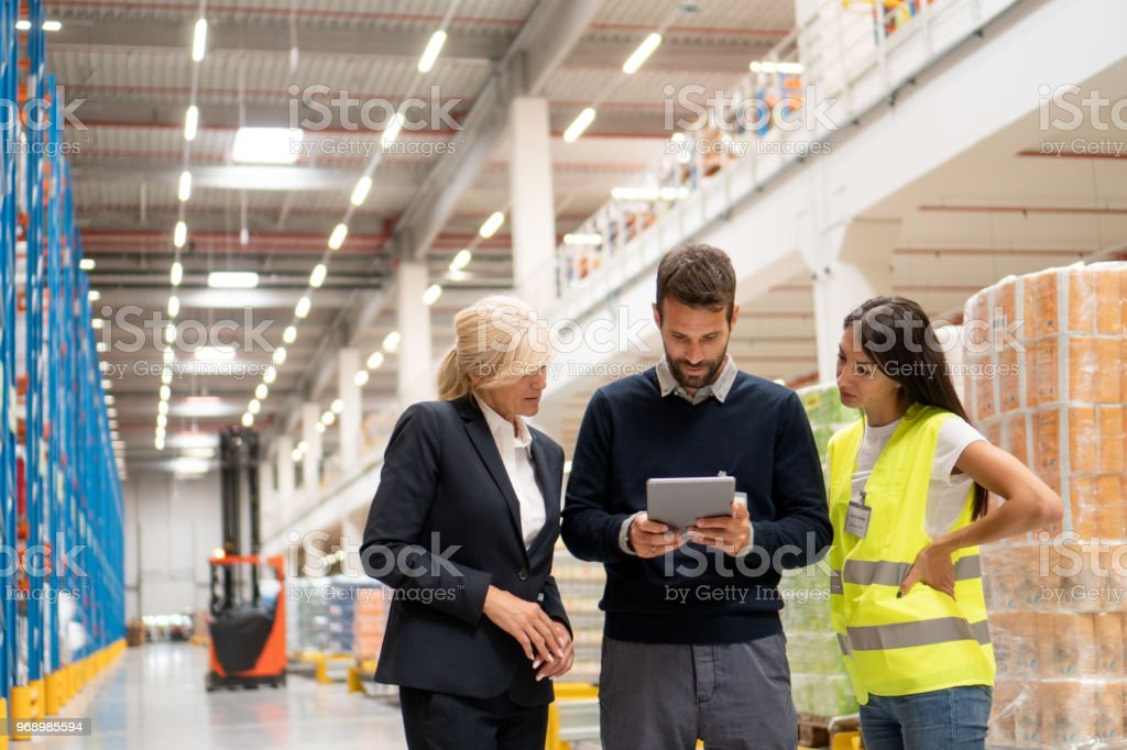 Ordering goods with managers - Royalty-free Adult Stock Photo