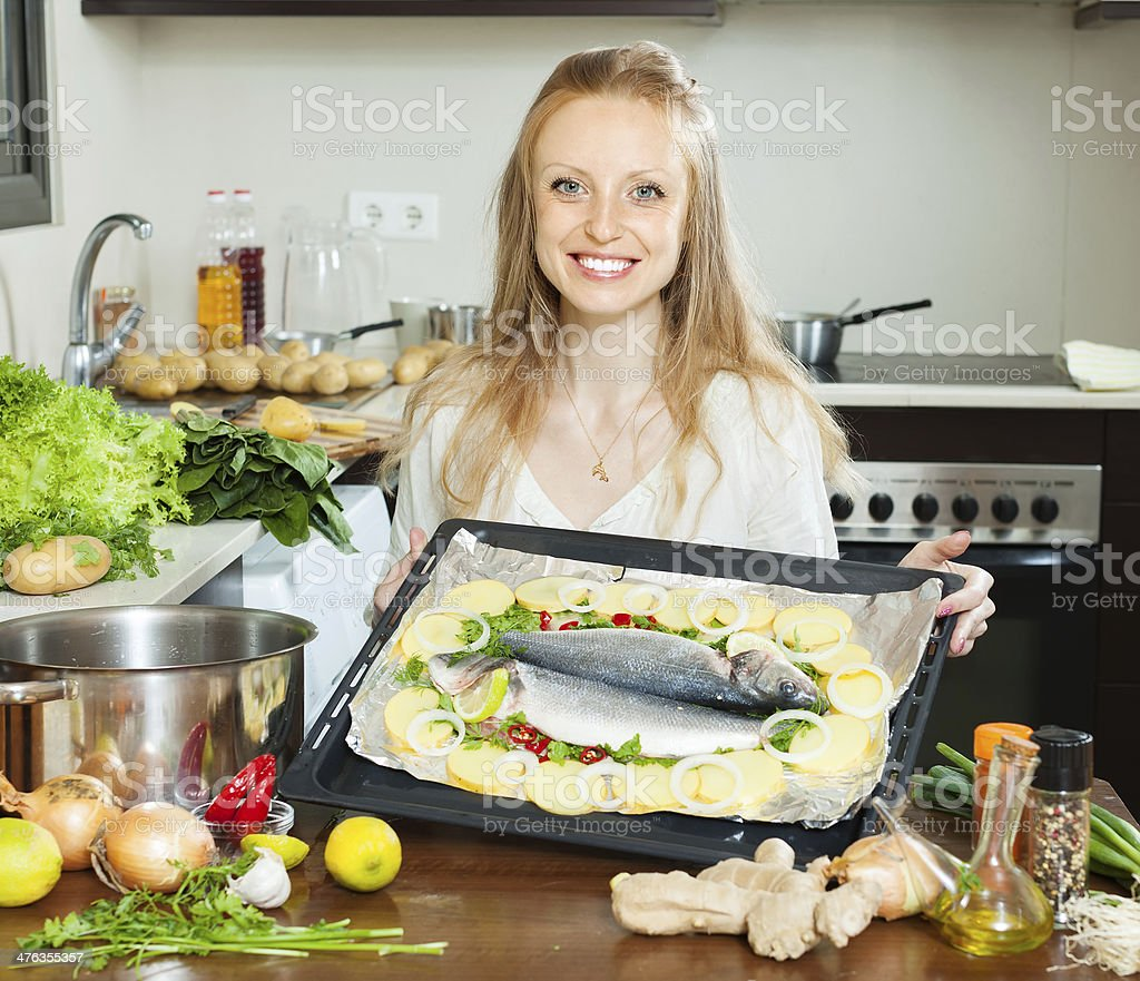 Ordinary housewife cooking fish  in sheet pan stock photo