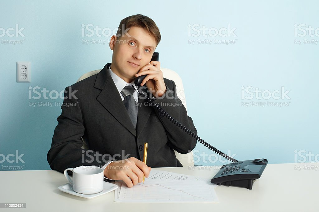 Ordinary official in office - talking on phone royalty-free stock photo