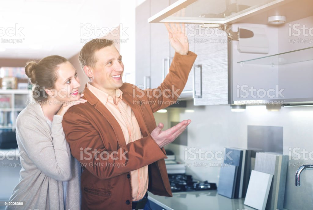Ordinary young customers choosing new kitchen stock photo