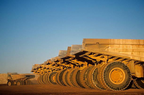 Ore hauling trucks in row, Telfer, Western Australia stock photo