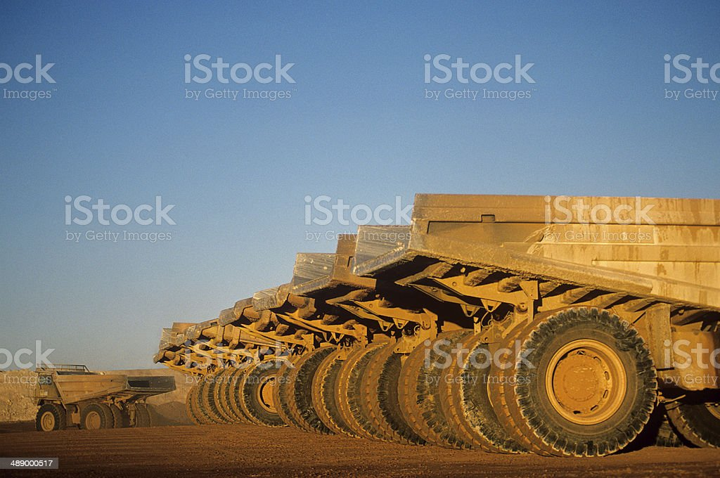 Ore hauling trucks in row, Telfer, Western Australia stock photo