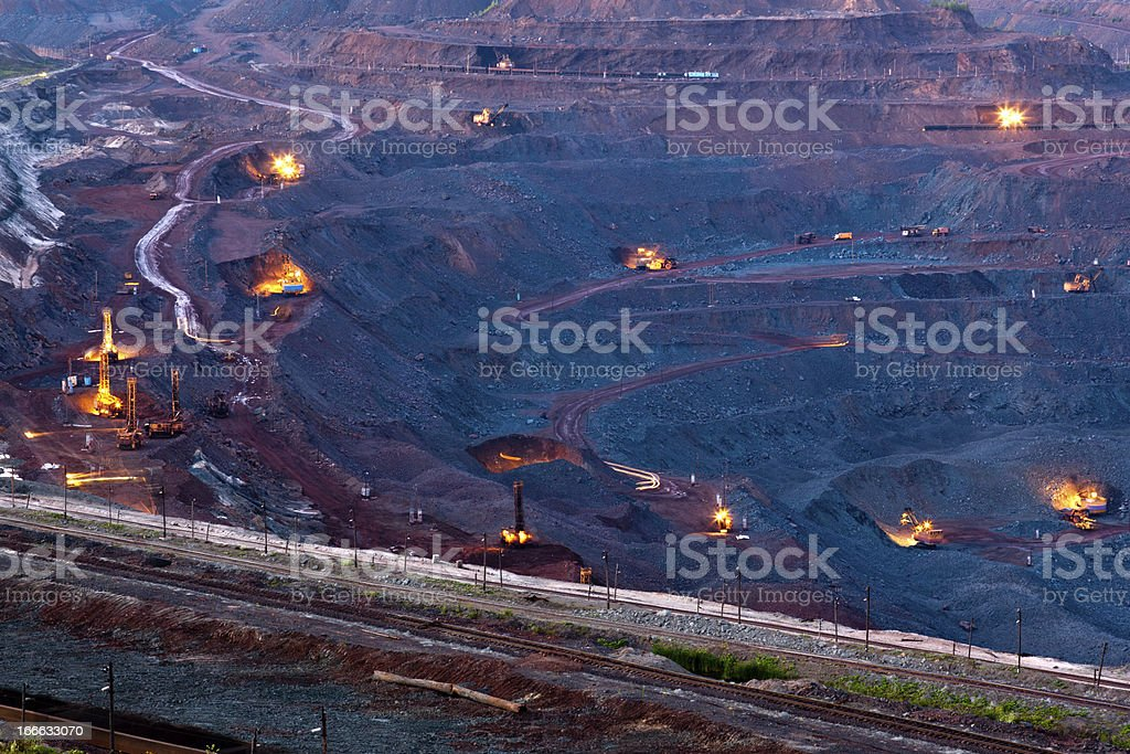 Ore mining in the quarry at night stock photo