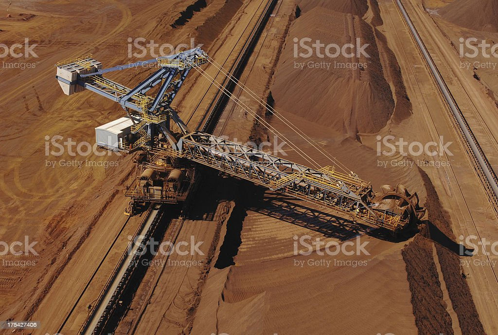 Ore reclaimer collecting crushed ore on a minesite. stock photo