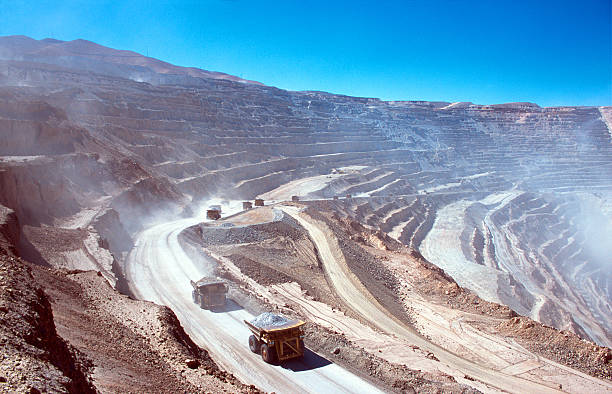 Ore trucks in an open-pit mine stock photo