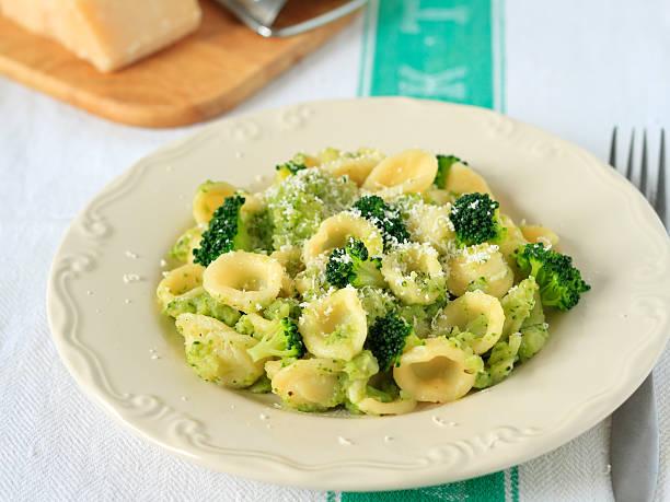 Orecchiette pasta Orecchiette pasta with broccoli and parmesan orecchiette stock pictures, royalty-free photos & images