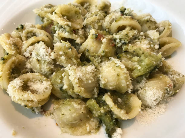 Orecchiette with broccoli, parmesan and bacon Orecchiette with broccoli, parmesan and bacon orecchiette stock pictures, royalty-free photos & images