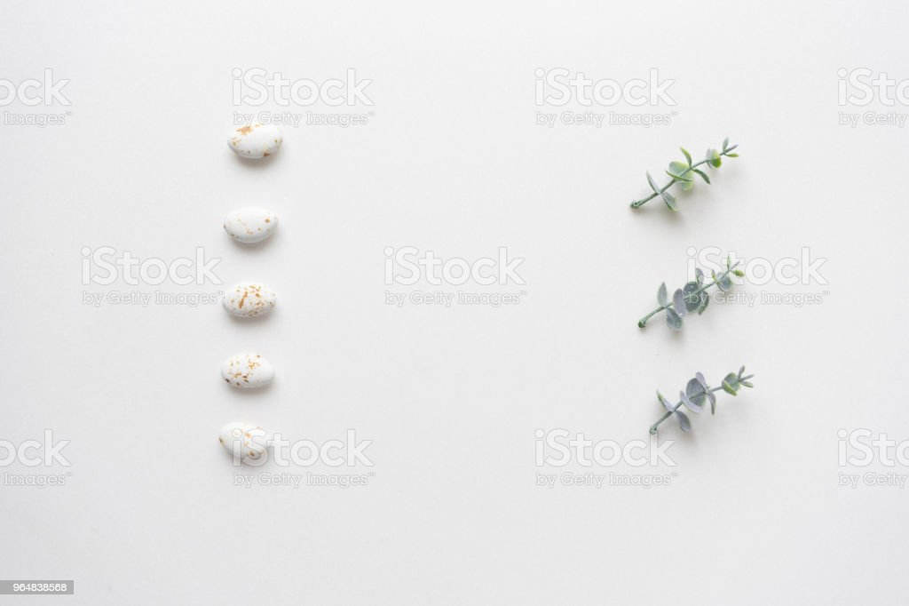 Oregano branches and wedding candys on white marble. Top view. royalty-free stock photo