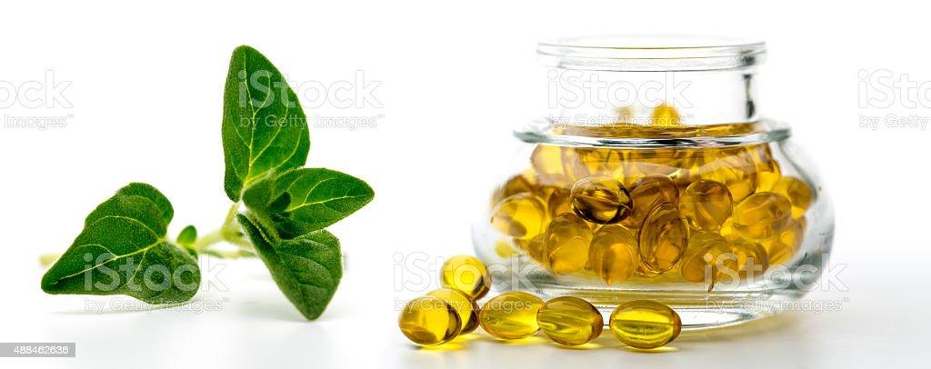 Oregano oil capsules stock photo