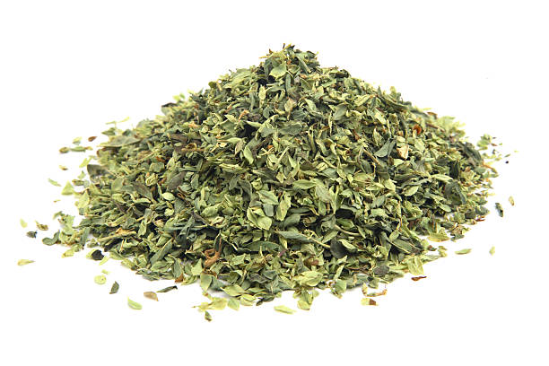 Oregano. A heap of oregano (origanum vulgare) isolated on white. oregano stock pictures, royalty-free photos & images