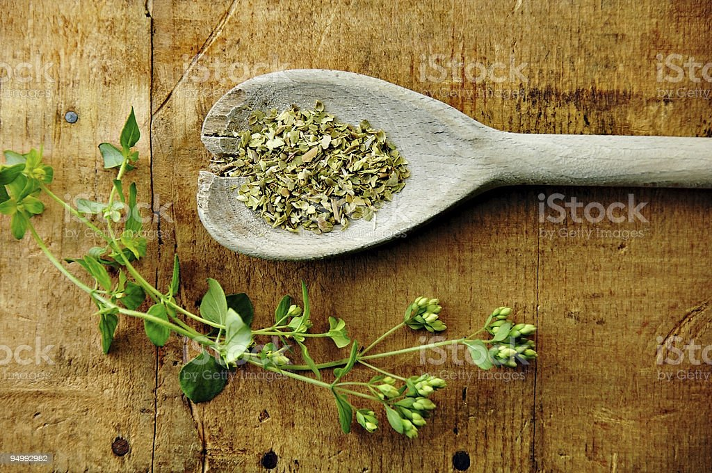 Oregano Sprig with Dried on a Wood Table royalty-free stock photo