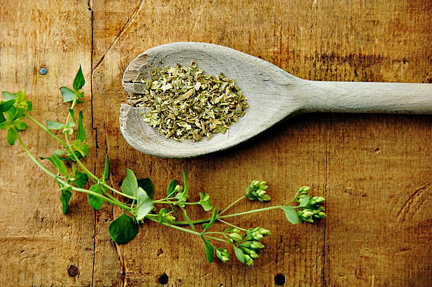 Oregano Sprig with Dried on a Wood Table  oregano stock pictures, royalty-free photos & images