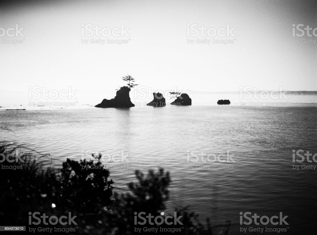 Oregon Coast in black and white with rocks stock photo